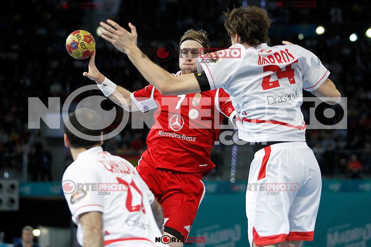Hungary's Gabor Csaszar (c) and Spain's Joan Canellas (l) and Viran Morros (r) during 23rd Men's Handball World Championship preliminary round match Hungary v Spain.January 17,2013. (ALTERPHOTOS/Acero)