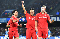 Erling Braut Haland of FC Salzburg (R) celebrates with Her Chan Hwang (C) and Takumi Minamino of FC Salzburg after scoring on penalty the goal of 0-1 for his side<br /> Napoli 05-11-2019 Stadio San Paolo <br /> Football Champions League 2019/2020 Group E<br /> SSC Napoli - FC Salzburg<br /> Photo Antonietta Baldassarre / Insidefoto