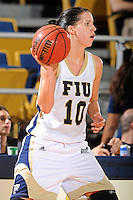 21 January 2012:  FIU guard Fanni Hutlassa (10) handles the ball in the first half as the Florida Atlantic University Owls defeated the FIU Golden Panthers, 50-49, at the U.S. Century Bank Arena in Miami, Florida.