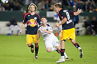 CARSON, CA - November 3, 2011: NY Red Bull defender Stephen Keel (22) and LA Galaxy forward Robbie Keane (14) during the match between LA Galaxy and NY Red Bulls at the Home Depot Center in Carson, California. Final score LA Galaxy 2, NY Red Bulls 1.