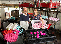 BNPS.co.uk (01202 558833)<br /> Pic: PhilYeomans/BNPS<br /> <br /> Louise Price with her father Derek(88) - third generation owner of the only tennis ball manufacturer left in Britain.<br /> <br /> Price of Bath was set up by her grandfather Joseph in the 1930's and after WW2 employed 120 people churning out 84,000 balls a week - nowadays it's the last tennis ball maker in the western world, and produces a much more modest 6000 balls a week from raw rubber from Malaysia to finished product.<br /> <br /> Louise's father Derek, who invented the rubber tiles used on nuclear powered submarines as well as running the family business, still works full time in the dickensian factory at the age of 88.