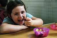 Pictured: Layla Grey, 6 enjoys fresh fruit at St Teilo Church in Clase, Swansea, UK. Friday 25 August 2017<br /> Re: Free food for children story, Swansea, Wales, UK.