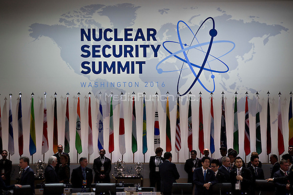 The Nuclear Security Summit logo stands above flags before an opening plenary entitled &quot;National Actions to Enhance Nuclear Security&quot; at the Nuclear Security Summit in Washington, D.C., U.S., on Friday, April 1, 2016. After a spate of terrorist attacks from Europe to Africa, U.S. President Barack Obama is rallying international support during the summit for an effort to keep Islamic State and similar groups from obtaining nuclear material and other weapons of mass destruction. <br /> Credit: Andrew Harrer / Pool via CNP/MediaPunch