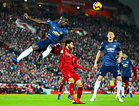 Manchester United's Eric Bailly wins a header under pressure from Liverpool's Mohamed Salah <br /> <br /> Photographer AlexDodd/CameraSport<br /> <br /> The Premier League - Liverpool v Manchester United - Sunday 16th December 2018 - Anfield - Liverpool<br /> <br /> World Copyright &copy; 2018 CameraSport. All rights reserved. 43 Linden Ave. Countesthorpe. Leicester. England. LE8 5PG - Tel: +44 (0) 116 277 4147 - admin@camerasport.com - www.camerasport.com