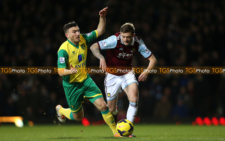 George McCartney of West Ham and Robert Snodgrass of Norwich - West Ham United vs Norwich City, Barclays Premier League at Upton Park, West Ham - 11/02/14 - MANDATORY CREDIT: Rob Newell/TGSPHOTO - Self billing applies where appropriate - 0845 094 6026 - contact@tgsphoto.co.uk - NO UNPAID USE