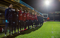 The England staff & bench stand for the National anthem during the International friendly match between England U19 and Bulgaria U19 at Adams Park, High Wycombe, England on 10 October 2016. Photo by Andy Rowland.