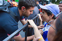 The USA's Chris Wondolowski signs the shirt of a Guatemalan fan  before the United States played Guatemala at Estadio Mateo Flores in Guatemala City, Guatemala in a World Cup Qualifier on Tue. June 12, 2012.