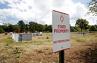 NWA Arkansas Democrat-Gazette/DAVID GOTTSCHALK  A section of property located near 19th Street and College Avenue Thursday, September 13, 2018, in Fayetteville is being cleared  by the University of Arkansas. A proposal to sell 4.69 acres of the property to nonprofit Serve NWA was set to be heard Thursday by the University of Arkansas Board of Trustees. The University of Arkansas is also seeking to sell the approximately 52 acres of nearby land.
