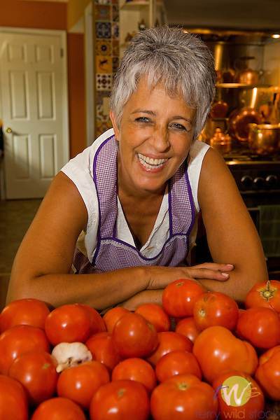 Rosie Wells in her kitchen with fresh tomatos.
