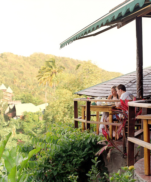 SOUFRIERE, ST.LUCIA : An young couple enjoys breakfast at Dasheene Restaurant  at Ladera Resort. Ladera is considered on of the best resorts in the Caribbean. Soufriere, St. Lucia.