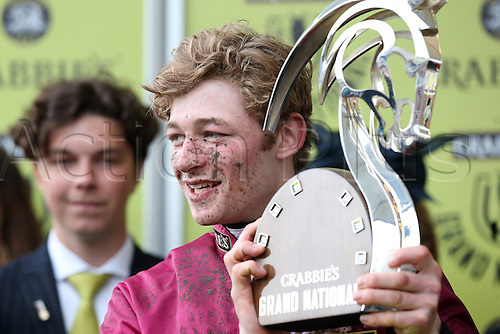 09.04.2016. Aintree, Liverpool, England. Crabbies Grand National Festival Day 3. Grand National Winner David Mullins with the Crabbies Grand National trophy.
