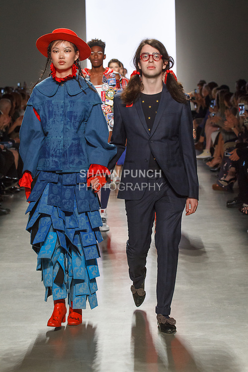 Graduating design student Erik Goldberg, walks runway with model at the close of 2017 Pratt fashion show on May 4, 2017 at Spring Studios in New York City.