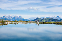 Austria, Tyrol, above Kirchberg in Tyrol, near Kitzbuhel: reservoir 'Ehrenbachhoehe', at background Loferer Steinberge mountains (left) and Leoganger Steinberge mountains (right) | Oesterreich, Tirol, oberhalb Kirchberg in Tirol: Speichersee Ehrenbachhoehe, im Hintergrund die Loferer Steinberge (links) und die Leoganger Steinberge (rechts)