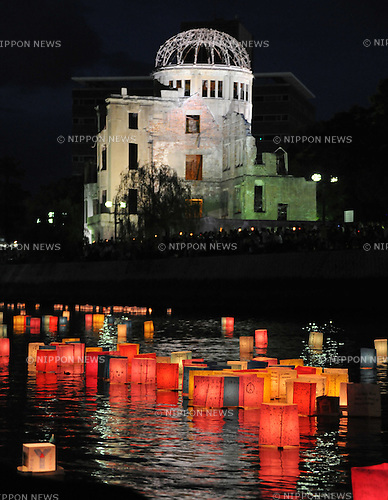 August 6, 2011, Hiroshima, Japan - Colorful paper lantern are leased on to the river running through the City of Hiroshima on Saturday, August 6, 2011, offering prayers for those died during and long after the atomic bombing of the city. The skeletal A-bomb Dome lit up in the background.....Japan observed the 66th anniversary of the atomic bombing with a moment of silence and the release of doves in a memorial ceremony as the nation struggles to put a different kind of nuclear disaster under control at the crippled power plant in northeast. The worlds first A-bomb destroyed most of this western industrial city, killing as many as 140,000 people in the summer of 1945. A second atomic bombing Aug. 9 that year in Nagasaki killed tens of thousands more and prompted the Japanese to surrender. (Photo by Natsuki Sakai/AFLO [3615] -mis-