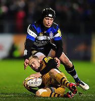 Jordan Williams of Bristol Rugby is tackled to ground by Jack Wilson of Bath Rugby. Aviva Premiership match, between Bath Rugby and Bristol Rugby on November 18, 2016 at the Recreation Ground in Bath, England. Photo by: Patrick Khachfe / Onside Images