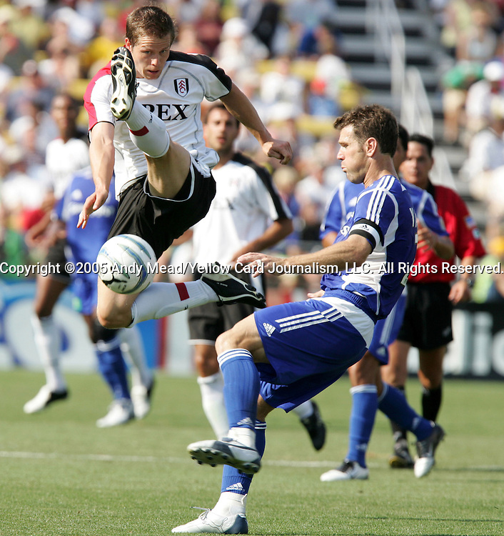 30 July 2005: Heider Helguson (l) lunges in an attempt to block a clearance by Greg Vanney (r). Major League Soccer's All-Stars defeated Fulham FC of the English Premier League 4-1 at Columbus Crew Stadium in Columbus, Ohio in the 2005 Sierra Mist MLS All-Star Game..