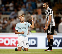 Calcio, Football - Juventus vs Lazio Italian Super Cup Final  <br /> Lazio's Ciro Immobile (l) reacts with Juventu's Giorgio Chiellini (r) during the Italian Super Cup Final football match between Juventus and Lazio at Rome's Olympic stadium, on August 13, 2017.<br /> UPDATE IMAGES PRESS/Isabella Bonotto