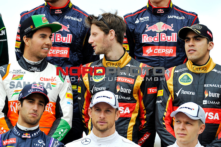 Sergio Perez (MEX) Force India Formula One Team - Romain Grosjean (FRA) Lotus Renault F1 Team<br />  Foto &copy; nph / Mathis