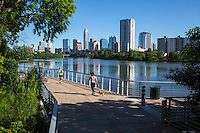 The Boardwalk Trail at Lady Bird Lake is Austin's favorite trail to run with a pet dog with a majestic view of the downtown Austin skyline - stock image.