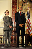 Washington, DC - January 22, 2009 -- United States President Barack Obama (R) and his Secretary of State Hillary Clinton stand together during an event where they announced the appointment of two new envoys to the Middle East, India and Pakistan, at the State Department in Washington, DC, USA on 22 January 2009. Former Senator George Mitchell will serve as envoy to the Middle East and former Ambassador Richard Holbrook will serve Pakistan and India..Credit: Matthew Cavanaugh - Pool via CNP