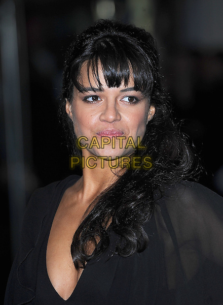 "MICHELLE RODRIGUEZ .Attending the World Premiere of ""Avatar"", Odeon Leicester Square, London, England, UK, .10th December 2009..portrait headshot fringe black .CAP/BEL.©Tom Belcher/Capital Pictures."