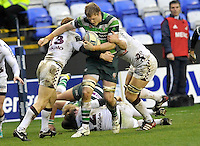 READING, ENGLAND : Jamie Gibson of London Irish tackled during the Amlin Challenge Cup match between London Irish and Bordeaux-Begles at Madejski Stadium on January 18, 2013 in Reading, England.