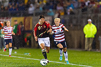 Megan Rapinoe (15) of the United States (USA) is defended by Linda Bresonik (10) of Germany (GER). The United States (USA) and Germany (GER) played to a 2-2 tie during an international friendly at Rentschler Field in East Hartford, CT, on October 23, 2012.
