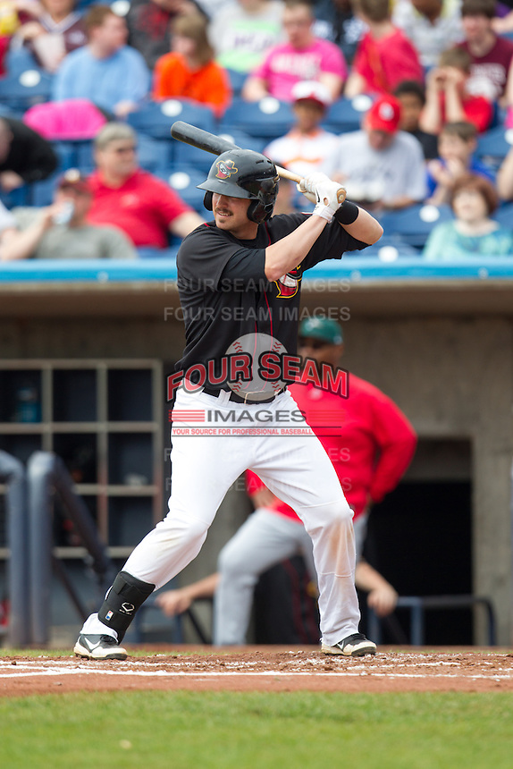 Quad Cities River Bandits third baseman Ryan Dineen #12 bats during a game against the Great Lakes Loons at Modern Woodmen Park on April 29, 2013 in Davenport, Iowa. (Brace Hemmelgarn/Four Seam Images)