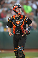 OAKLAND, CA - AUGUST 24:  Buster Posey #28 of the San Francisco Giants runs back to the dugout during the game against the Oakland Athletics at the Oakland Coliseum on Saturday, August 24, 2019 in Oakland, California. Both teams are wearing special uniforms for Players Weekend. (Photo by Brad Mangin)