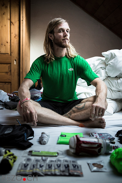 Chamonix, France - 08/29/2013: Timothy (Tim) Olson, 30, ultra runner for The North Face from Ashland, Oregon, prepares himself and his material for the race in a house rented in Chamonix by his sponsor. Credit: Niels Ackermann for the New York Times