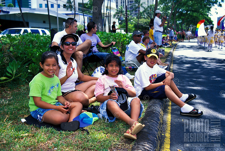 Spectators at the annual aloha week parade