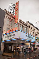 The marquee of the Apollo Theater in Harlem in New York on a rainy Friday, December 6, 2013 shows a memorial to the late Nelson Mandela. The South African civil rights activist passed away at the age of 95. Mandela visited Harlem in 1990 on his first visit to New York. (© Richard B. Levine)