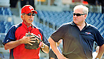 9 July 2011: Washington Nationals Manager Davey Johnson tosses ball and chats with Two-time MLB All-Star, now MASN broadcaster, Ray Knight (right) prior to a game against the Colorado Rockies at Nationals Park in Washington, District of Columbia. The Nationals were edged out by the Rockies 2-1, dropping the second game of their 3-game series. Mandatory Credit: Ed Wolfstein Photo