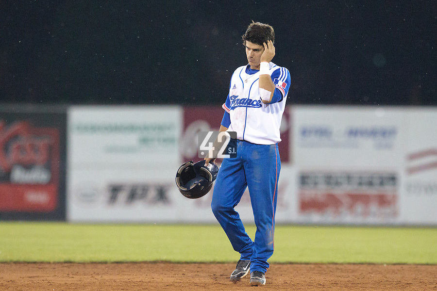 21 August 2010: Maxime Lefevre of Team France looks dejected during Russia 13-1 win in 7 innings over France, at the 2010 European Championship, under 21, in Brno, Czech Republic.