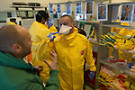 Training center in Amsterdam, Netherlands for MSF (Doctors Without Borders) staff being trained in EBOLA protocols for work in Africa such as safe dressing and undressing of protective suits and gear.