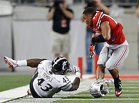 Ohio State Buckeyes running back Jalin Marshall (17) breaks a tackle by Cincinnati Bearcats linebacker Nick Temple (43) after losing his helmet during the fourth quarter of Saturday's NCAA Division I football game at Ohio Stadium in Columbus on September 27, 2014. (Columbus Dispatch photo by Jonathan Quilter)