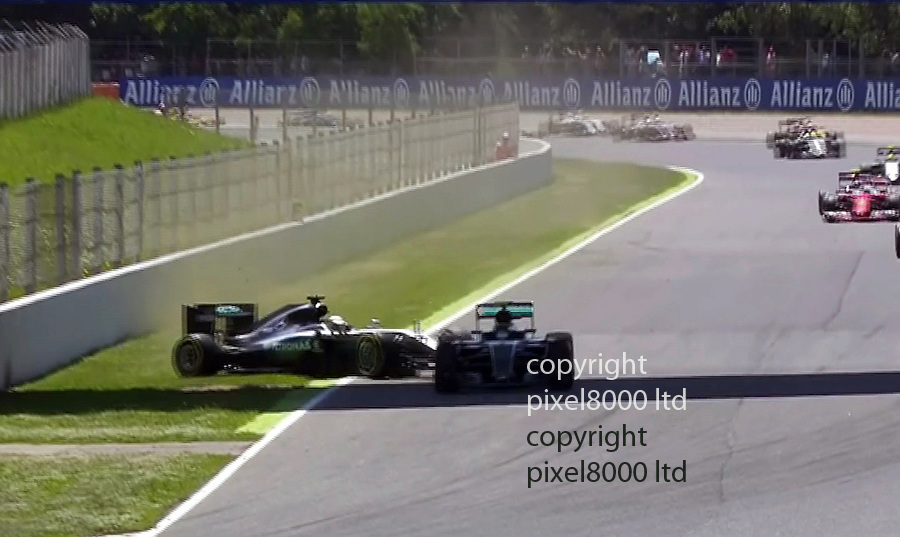 "pic shows: F1 Spanish Grand Prix<br /> Nico Rosberg and Lewis Hamilton take each other out on lap one.<br /> <br /> Mercedes execs watching mouth ""scheiss""   are NOT happy. There's lots of shaking of heads in their garage. <br /> <br /> Looking at the replays, Lewis Hamilton was squeezed out by Nico Rosberg as the reigning world champion tried to overtake. He was sent onto the grass, spun and clipped the rear of Rosberg's car.<br /> <br /> <br /> <br /> Picture by Pixel8000 07917221968"