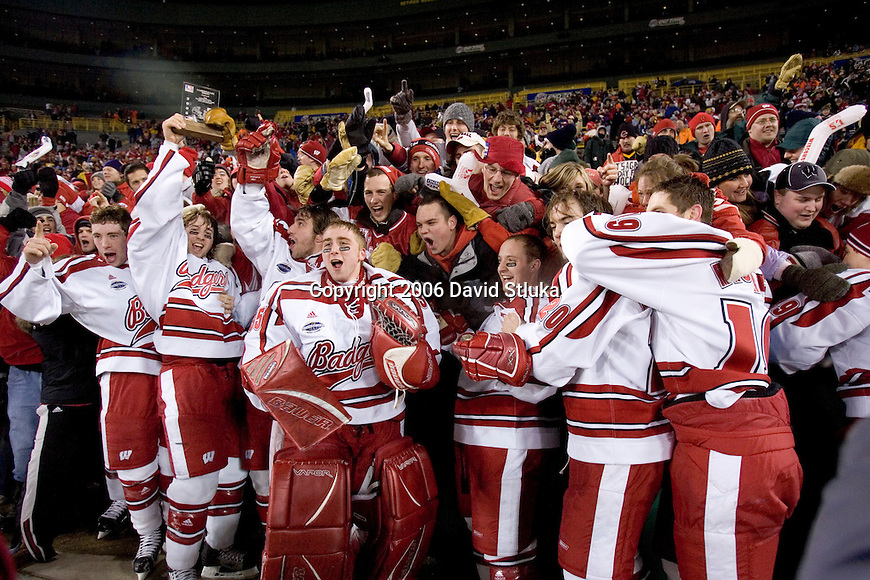 GREEN BAY, WI - FEBRUARY 11: The Wisconsin Badgers celebrate their victory with their fans over the Ohio State Buckeyes at Lambeau Field on February  11, 2006 in Green Bay, Wisconsin. The Badgers defeated the Buckeyes 4-2. (Photo by David Stluka)