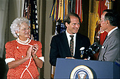 United States President George H.W. Bush and first lady Barbara Bush present the Presidential Citizens Medal to Richard N. Haas, National Security Council Senior Director for Near East and South Asian Affairs, during a ceremony in the East Room of the White House in Washington, DC on July 3, 1991. Haas is being honored for his efforts to ensure the success of Operation Desert Shield / Operation Desert Storm and the liberation of Kuwait.<br /> Credit: Ron Sachs / CNP