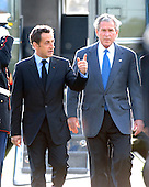 Camp David, MD - October 18, 2008 --  President Nicolas Sarkozy of France, who also serves as this year's rotating President of the European Union (EU), left, and United States President George W. Bush, right, walk to the microphones to make statements at the Presidential Retreat near Thurmont, Maryland for talks on Saturday, October 18, 2008.  The two European leaders stopped at Camp David to meet with President Bush to discuss the economy on their way home from a summit in Canada to try to convince Bush to support a summit by year's end to try to reform the world financial system..Credit: Ron Sachs / Pool via CNP