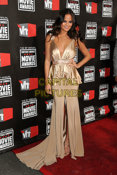 CHRISTINE TEIGEN .at The16th Annual Critics' Choice Movie Awards held at The Hollywood Palladium in Hollywood, California, USA, January 14th, 2011..full length beige dress silk satin peplum ruffle  Chrissy hand on hip long maxi .CAP/ADM/BP.©Byron Purvis/AdMedia/Capital Pictures.