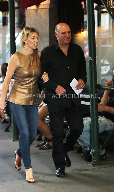 ACEPIXS.COM<br /> <br /> July 22 2014, New York City<br /> <br /> Businessman and 'Shark Tank' TV personality Kevin O'Leary walks in Soho with his wife Linda on July 22 2014 in New York City<br /> <br /> By Line: Zelig Shaul/ACE Pictures<br /> <br /> ACE Pictures, Inc.<br /> www.acepixs.com<br /> Email: info@acepixs.com<br /> Tel: 646 769 0430