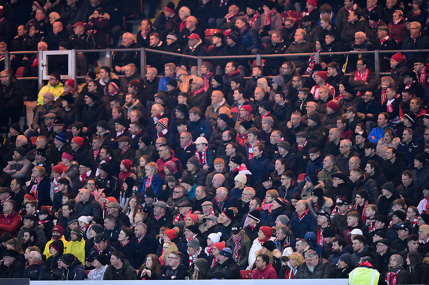 Lincoln City fans watch their team in action<br /> <br /> Photographer Andrew Vaughan/CameraSport<br /> <br /> The EFL Sky Bet League Two - Lincoln City v Yeovil Town - Friday 8th March 2019 - Sincil Bank - Lincoln<br /> <br /> World Copyright © 2019 CameraSport. All rights reserved. 43 Linden Ave. Countesthorpe. Leicester. England. LE8 5PG - Tel: +44 (0) 116 277 4147 - admin@camerasport.com - www.camerasport.com