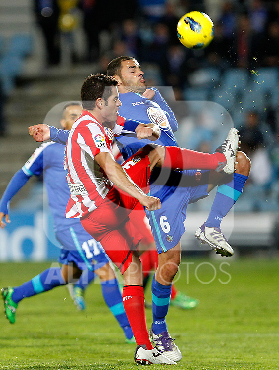 Getafe's Mehdi Lacen (r) and Atletico de Madrid's Antonio Lopez during La Liga match.November 6,2011. (ALTERPHOTOS/Acero)