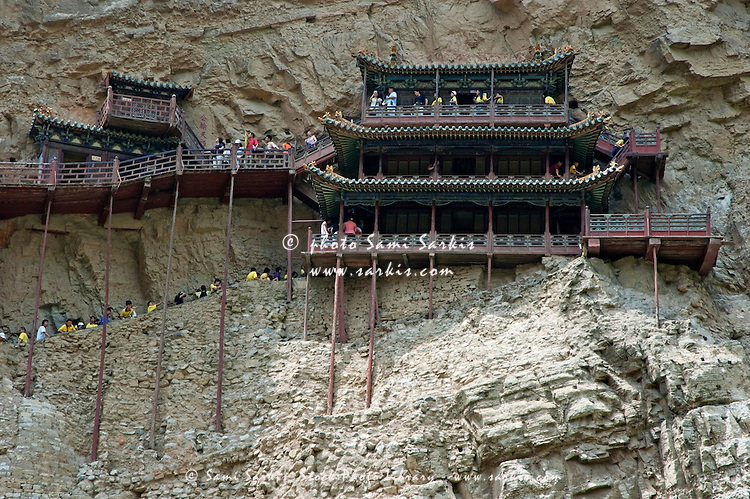 Crowds visiting the Buddhist Hanging Monastery on the side of Mount Heng in Shanxi, China.