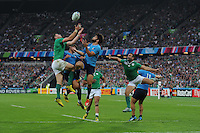 Robbie Henshaw of Ireland and Luke McLean of Italy compete for the high ball during Match 28 of the Rugby World Cup 2015 between Ireland and Italy - 04/10/2015 - Queen Elizabeth Olympic Park, London<br /> Mandatory Credit: Rob Munro/Stewart Communications