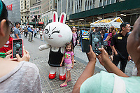 "Costumed characters representing Line ""stickers"" in front of the New York Stock Exchange decorated for the Japanese messaging company Line's initial public offering on Thursday, July 14, 2016. Line Corp., a popular messaging app in Japan is owned by South Korean Naver Corp. Line has 218 million active users monthly, with Japan, Taiwan and Indonesia accounting for two-thirds of them.   (© Richard B. Levine)"