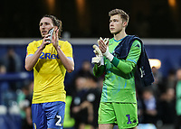 Leeds United's Luke Ayling and Bailey Peacock-Farrell applaud their side's travelling supporters at the end of the game<br /> <br /> Photographer Andrew Kearns/CameraSport<br /> <br /> The Emirates FA Cup Third Round - Queens Park Rangers v Leeds United - Sunday 6th January 2019 - Loftus Road - London<br />  <br /> World Copyright &copy; 2019 CameraSport. All rights reserved. 43 Linden Ave. Countesthorpe. Leicester. England. LE8 5PG - Tel: +44 (0) 116 277 4147 - admin@camerasport.com - www.camerasport.com