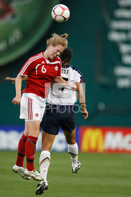 Canada defender Sophie Schmidt (6) and United States midfielder Shannon Boxx (7) go up for a header. The women's national team of the United States defeated Canada 6-0 during an international friendly at Robert F. Kennedy Memorial Stadium in Washington, D. C., on May 10, 2008.