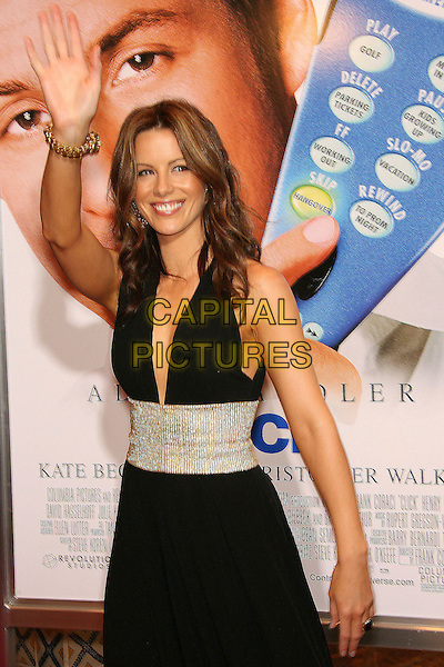 "KATE BECKINSALE.Los Angeles Premiere of ""Click"" held at Mann Village Theater, Westwood, California, USA,  14 June 2006.\.half length waving hand black halterneck dress low cut plunging neckline gold waist.Ref: ADM/ZL.www.capitalpictures.com.sales@capitalpictures.com.©Zach Lipp/AdMedia/Capital Pictures."